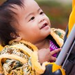 Stock Photo: Asifemale baby smile in perambulator