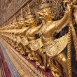 Golden garuda decoration in row in temple of emerald Buddha vert — Stock Photo