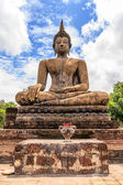 Ancient Budddha statue in Sukhothai from back — Stock Photo