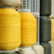 Yellow and gray silk thread in spool — Stock Photo #21018945