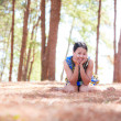 Thai woman sit and smile in park — Stock Photo #26128731