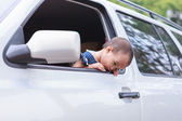 Bad feeling baby out of window — Stock Photo