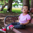 Lonely Asian baby girl sitting on bench — Стоковая фотография