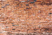Old orange cracked brick wall — Stock Photo