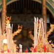 Burning incense in front of temple — Stock Photo #8811933