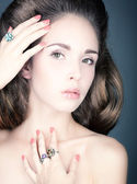 Portrait of a young woman with jewelry. — Stock Photo