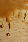Honey flowing through the wood — Stock Photo