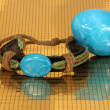 Bracelet and marble egg — Stock Photo