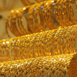 Gold bracelets — Stock Photo