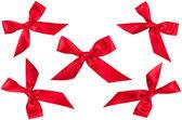Sada pěti červenou stužku luky v různých polohách — Stock fotografie