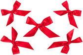 Set of five red ribbon bows in different position — Stockfoto
