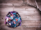 Christmas decoration made from recycled magazine paper — Stock Photo
