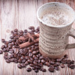 Stock Photo: Cup of black coffee, cinnamon, aniseed and roasted coffee beans