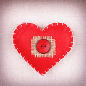 Heart with red button — Stock Photo