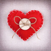 Red heart with button and bow — Stock Photo