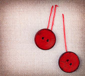 Two wooden red sewed buttons — Stok fotoğraf