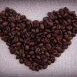 Dark roasted coffee beans  in the shape of a heart — 图库照片