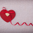 Stock Photo: Red wooden heart with silk ribon bow on it