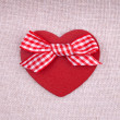 A red wooden hearth with a fabric bow — Stock Photo