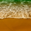 Soft sea waves on the sandy beach — Stockfoto