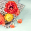 Colorful ranunculus flower on vintage wicker tray — Stock Photo