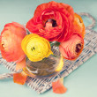 Colorful ranunculus flower on a wicker tray  — Stock Photo