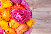 Bouquet of beautiful colorful ranunculus flower on wooden backgr — Stock Photo