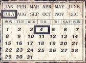 A vintage style universal calendar with date set to July 4th, In — Stock Photo