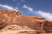 A Wadi Rum mountain with unusual rolling stone on it — Stock Photo