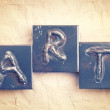 The word ART made from metal letters on an old vintage paper b — Stock fotografie