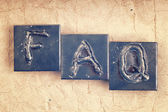 "The abbreviation ""FAQ"" made from metal letters on an old vintage — Stock Photo"