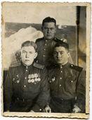 Urss - circa de 1940: foto vintage de soldados não identificados com uniforme do exército soviético. — Fotografia Stock