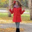 Stock Photo: Beautiful young woman in red coat
