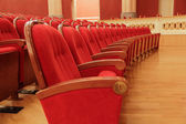 Background of red theatrical red chairs — Foto Stock