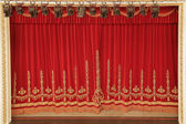 Theatrical red curtain — Stock Photo