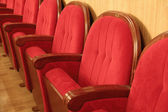 Background of red theatrical red chairs — Stok fotoğraf