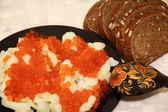 Russian national food caviar and potatoes — Stock Photo