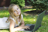 Cute girl with laptop — Stock Photo