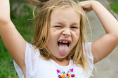 Girl makes faces imitate witch — Stock Photo