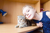 Girl with grey kitty — Stock Photo