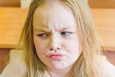 Discontented younger schoolgirl — Stock Photo