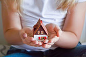 Dollhouse in human hand — Stock Photo
