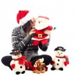 Girl sitting down with her christmas toys — Stock Photo