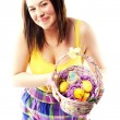 beautiful young girl holding basket of colored eggs — Stock Photo