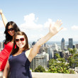 Friends standing by Binoculars at tourist area — Stock Photo