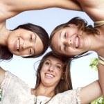 Three young beautiful girls having fun — Stock Photo