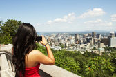 Beautiful Asian girl standing at tourist area — Stock Photo