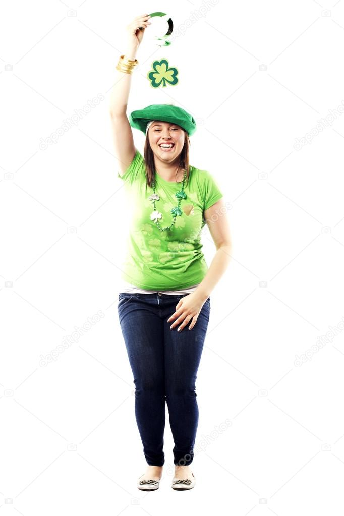 Irish young lady dressed for a st patricks day celebration standing happily excited — Stock Photo #13291441