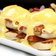 Double stacked eggs benedict — Stock Photo