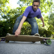 Young teenager rolling around on his longboard — Stock Photo